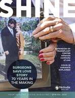 Spring 2021 Shine Magazine Cover featuring older couple holding hands holding a photos of them decades before
